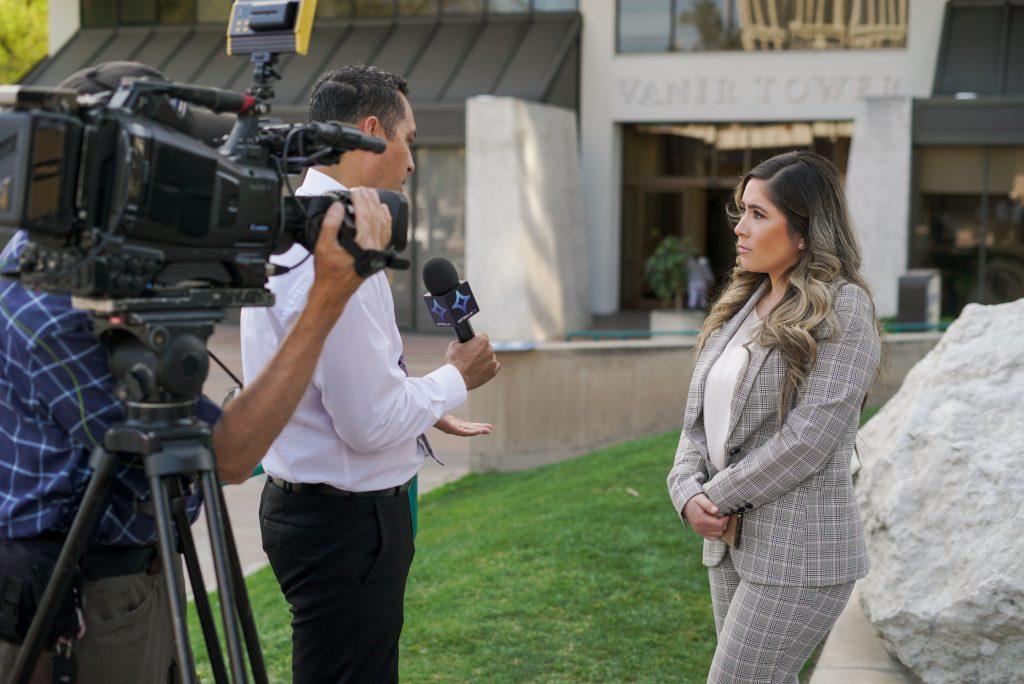 MIrna Cisneros doing a media interview